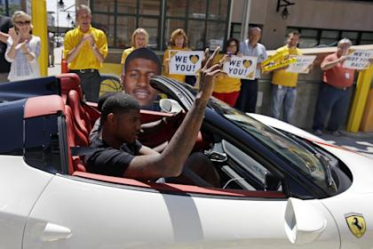 Paul George is greeted by Bankers Life Fieldhouse employees as he arrives for his news conference. (AP)