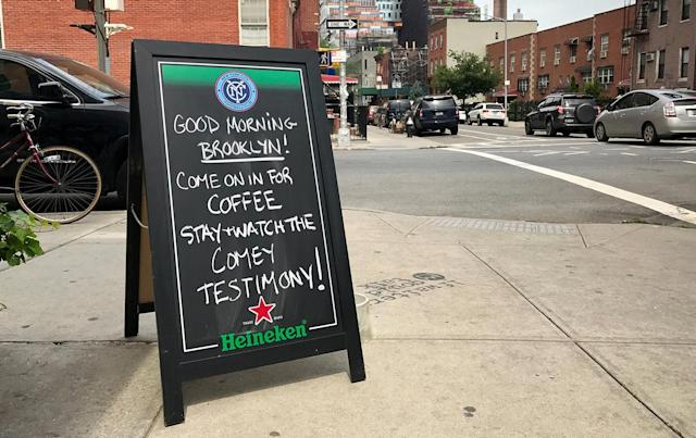 <p>A sign welcomes people into South 4th Bar to watch former FBI director James Comey testify before the Senate Intelligence committee in Brooklyn, New York, June 8, 2017. (Yahaira Jacquez/Reuters) </p>