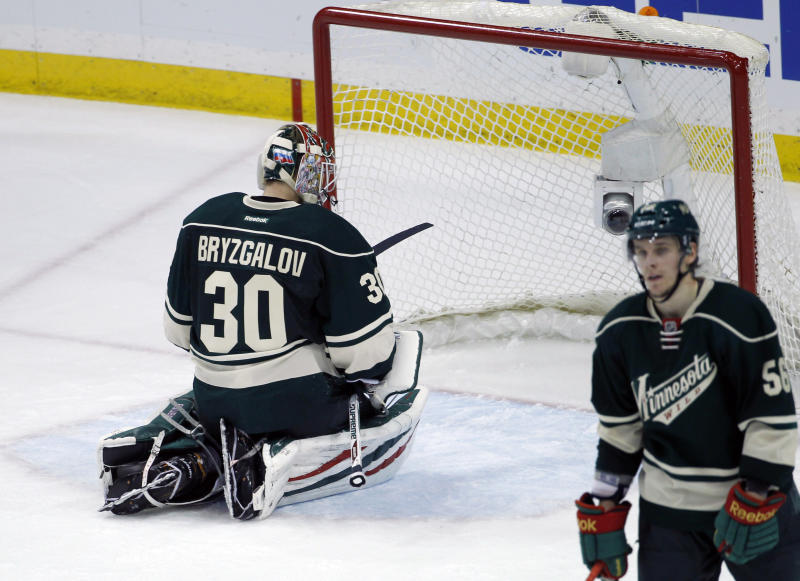 Minnesota Wild goalie Ilya Bryzgalov (30), of Russia, kneels in front of the net after Chicago Blackhawks right wing Patrick Kane scored the game-winning goal on him during overtime of Game 6 of an NHL hockey second-round playoff series in St. Paul, Minn., Tuesday, May 13, 2014. The Blackhawks won 2-1. (AP Photo/Ann Heisenfelt)