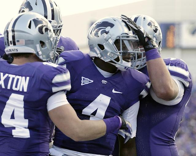 Kansas State quarterback Daniel Sams, center, celebrates in the end zone after scoring a touchdown during the first half of an NCAA college football game against TCU, Saturday, Nov. 16, 2013, in Manhattan, Kan. (AP Photo/Charlie Riedel)