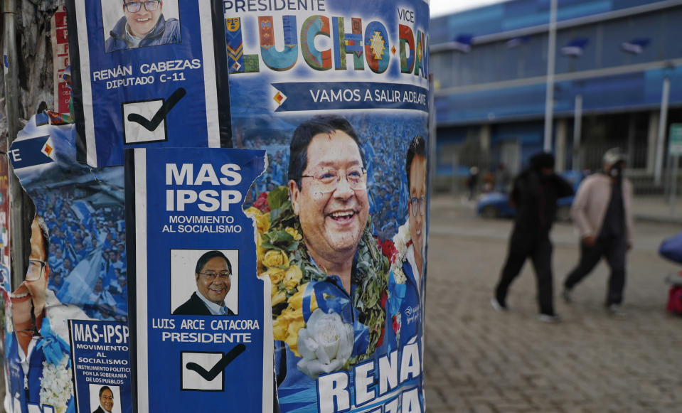 Election posters promoting presidential candidate and one of two leading contenders Luis Arce, representing the Movement Towards Socialism political party better known by its acronym MAS, cover a pole in El Alto, Bolivia, Friday, Oct. 16, 2020. The presidential election on Sunday gives Bolivians a chance for a political reset as they struggle with the dramatic costs of the COVID-19 pandemic. (AP Photo/Juan Karita)