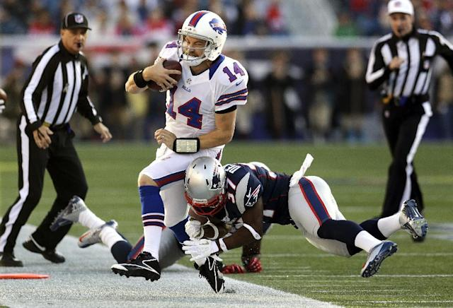 Buffalo Bills quarterback Ryan Fitzpatrick (14) is hit by New England Patriots cornerback Alfonzo Dennard, right, as he scrambles out of bounds during the second quarter of an NFL football game at Gillette Stadium in Foxborough, Mass., Sunday, Nov. 11, 2012. (AP Photo/Elise Amendola)