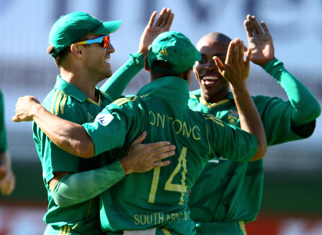 PORT ELIZABETH, SOUTH AFRICA - DECEMBER 26: Faf du Plessis, Justin Ontong, and Aaron Phangiso of South Africa celebrate during the 3rd T20 International match between South Africa and New Zealand at AXXESS St Georges on December 26, 2012 in Port Elizabeth, South Africa. (Photo by Richard Huggard / Gallo Images/Getty Images)