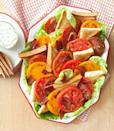 """<p>Juicy tomatoes, bacon, and crisp lettuce make up this amazingly fresh BBQ salad. But the best part? The bread. </p><p><em><a href=""""https://www.goodhousekeeping.com/food-recipes/a14604/heirloom-blt-salad-recipe-ghk0813/"""" rel=""""nofollow noopener"""" target=""""_blank"""" data-ylk=""""slk:Get the recipe for Heirloom BLT Salad »"""" class=""""link rapid-noclick-resp"""">Get the recipe for Heirloom BLT Salad »</a> </em></p>"""