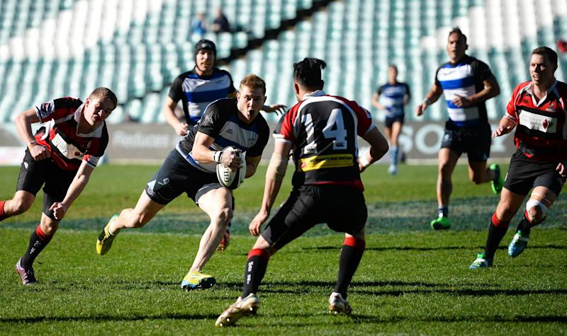 The Sydney Convicts, an all gay rugby team, faces Macquarie University at the Allianz Stadium in Sydney on July 6, 2014