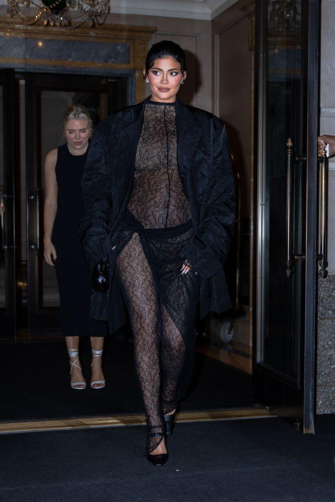 Kylie Jenner dressed her bump in a sheer lace catsuit last night in New York. (Getty Images)