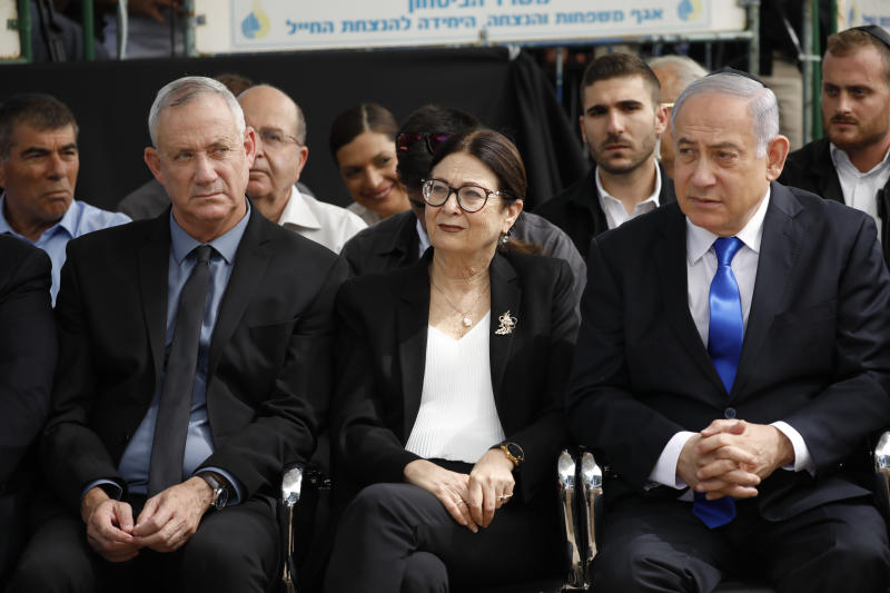Blue and White party leader Benny Gantz, left, Esther Hayut, the Chief Justice of the Supreme Court of Israel, and Prime Minister Benjamin Netanyahu attend a memorial service for former President Shimon Peres in Jerusalem, Thursday, Sept. 19, 2019. Israelis are contending with the prospect of a third election, two days after an unprecedented repeat election left the country's two main political parties deadlocked, with neither Prime Minister Benjamin Netanyahu nor his rivals holding a clear path to a coalition government. (AP Photo/Ariel Schalit)