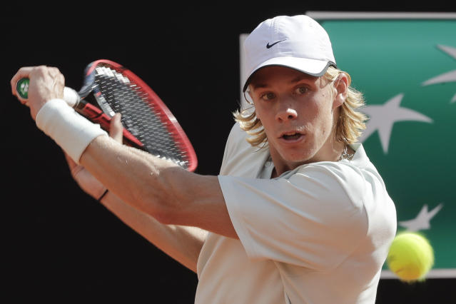 Canada's Denis Shapovalov returns the ball to Spain's Rafael Nadal, at the Italian Open tennis tournament in Rome, Thursday, May 17, 2018 (AP Photo/Alessandra Tarantino)