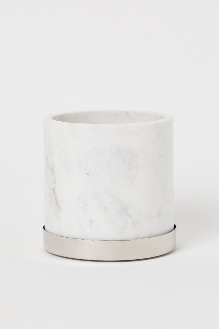 <p>Put one of your favorite plants in this <span>H&amp;M Marble Plant Pot With Saucer</span> ($50).</p>