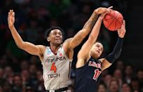 <p>Nickeil Alexander-Walker #4 of the Virginia Tech Hokies competes for the ball wtih Georgie Pacheco-Ortiz #11 of the Liberty Flames in the second half during the second round of the 2019 NCAA Men's Basketball Tournament at SAP Center on March 24, 2019 in San Jose, California. (Photo by Ezra Shaw/Getty Images) </p>