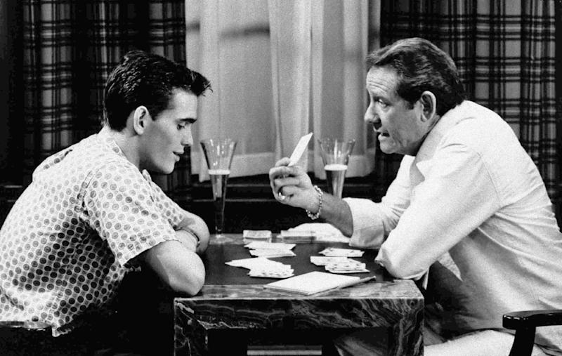 """FILE - In this undated file photo, veteran actor Richard Crenna, right, and Matt Dillon play cards in scene from the 1984 film """"The Flamingo Kid."""" (AP Photo/20th Century Fox, File)"""