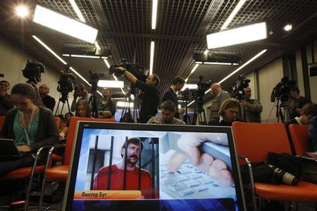 Journalists attend a news conference of Russian arms dealer Bout, his wife and lawyer via a video link from the U.S. in Moscow