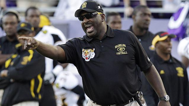 FILE - In this Sept. 8, 2012, file photo, Grambling State head coach Doug Williams yells from the sideline during the first half of an NCAA college football game against TCU in Fort Worth, Texas. Grambling State announced Wednesday, Sept. 11, 2013, that they fired Williams, and bought out the remainder of his contract after the team lost its first two games of the season. (AP Photo/LM Otero, File)