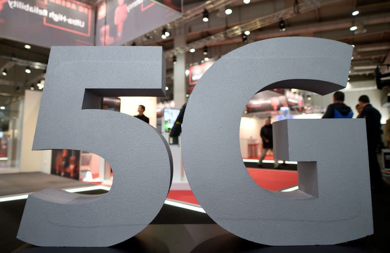 FILE PHOTO: A logo of the upcoming mobile standard 5G is pictured at the Hanover trade fair, in Hanover