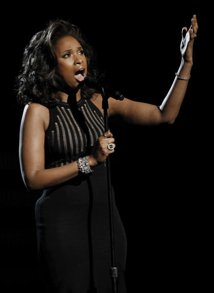 """Jennifer Hudson performs """"I Will Always Love You"""" during the In Memoriam portion of the 54th annual Grammy Awards on Sunday, Feb. 12, 2012 in Los Angeles. (AP Photo/Matt Sayles)"""