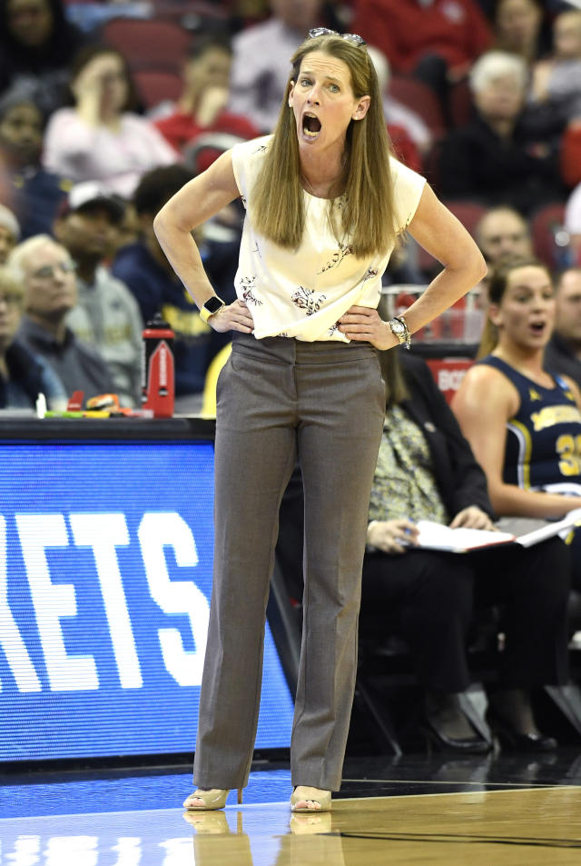 Michigan head coach Kim Barnes Arico shouts instructions to her team during the second half of a second-round game against Louisville in the NCAA women's college basketball tournament in Louisville, Ky., Sunday, March 24, 2019. Louisville won 50-71. (AP Photo/Timothy D. Easley)