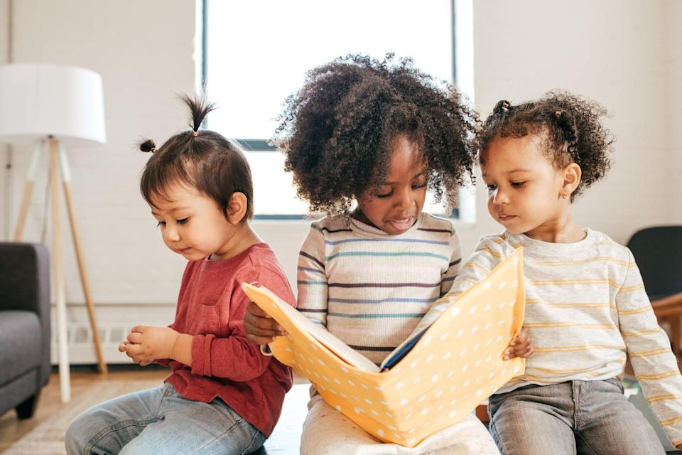 Toddlers busy with educational book