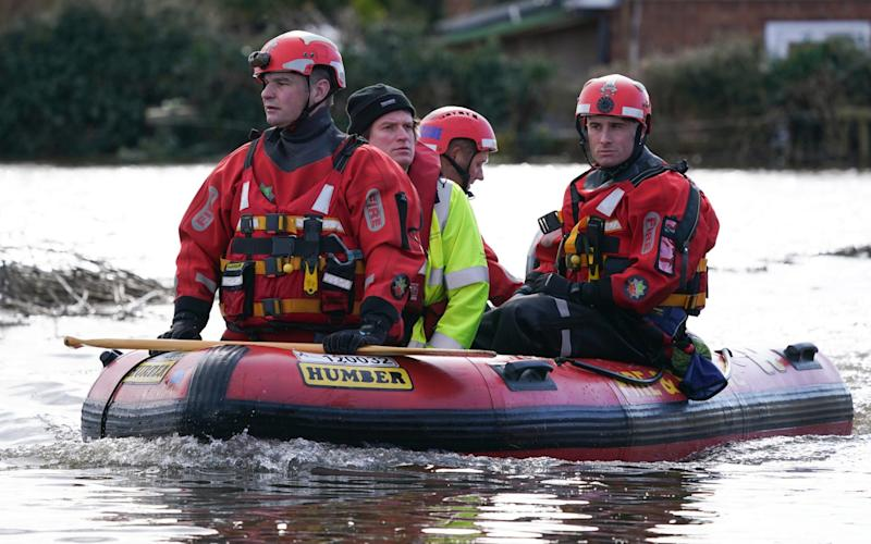 Rescue workers in East Cowick, Yorkshire, brave the floods - Ian Forsyth/Getty Images Europe