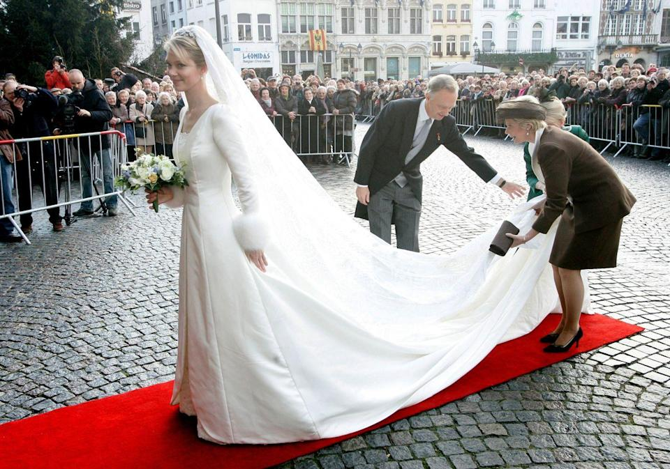 <p>The Archduchess chose long sleeves with fur cuffs for her December wedding.</p>