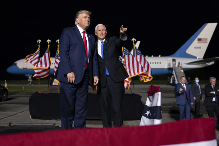 President Donald Trump and Vice President Mike Pence arrive for a campaign rally, Friday, Sept. 25, 2020, in Newport News, Va. (AP Photo/Evan Vucci)