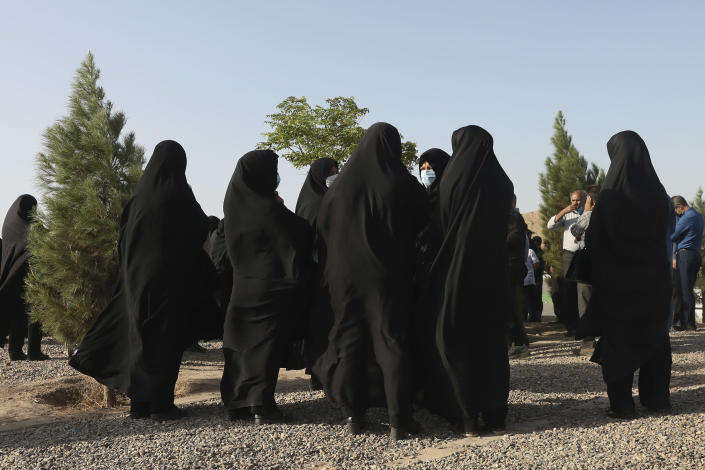 Relatives and family friends attend a funeral procession for their loved one, a Covid-19 victim, at Behesht-e-Masoumeh cemetery just outside the city of Qom, some 80 miles (125 kilometers) south of the capital Tehran, Iran, Wednesday, Sept. 15, 2021. (AP Photo/Vahid Salemi)