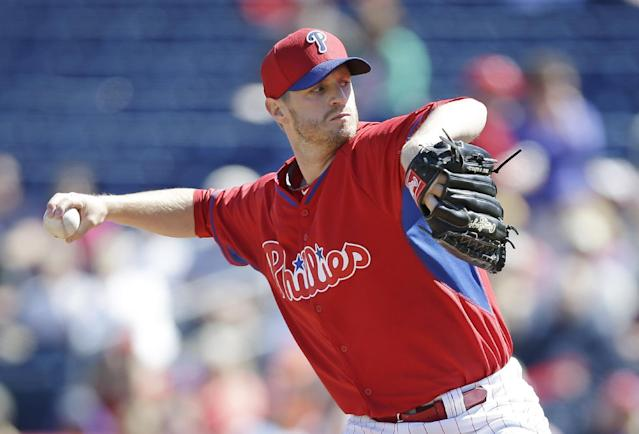 Philadelphia Phillies starting pitcher Kyle Kendrick throws a pitch during the first inning of an exhibition baseball game against the Detroit Tigers Friday, Feb. 28, 2014, in Clearwater, Fla. (AP Photo/Charlie Neibergall)