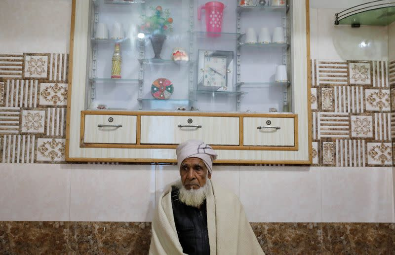 Munshi Ahmed, father of Zaheer Ahmed, who died during clashes with police following protests against a new citizenship law, sits inside house in Meerut