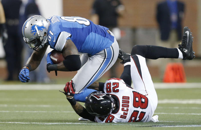 Detroit Lions wide receiver Calvin Johnson (81) is stopped by Atlanta Falcons free safety Thomas DeCoud (28) during the second quarter of an NFL football game at Ford Field in Detroit, Saturday, Dec. 22, 2012. (AP Photo/Rick Osentoski)