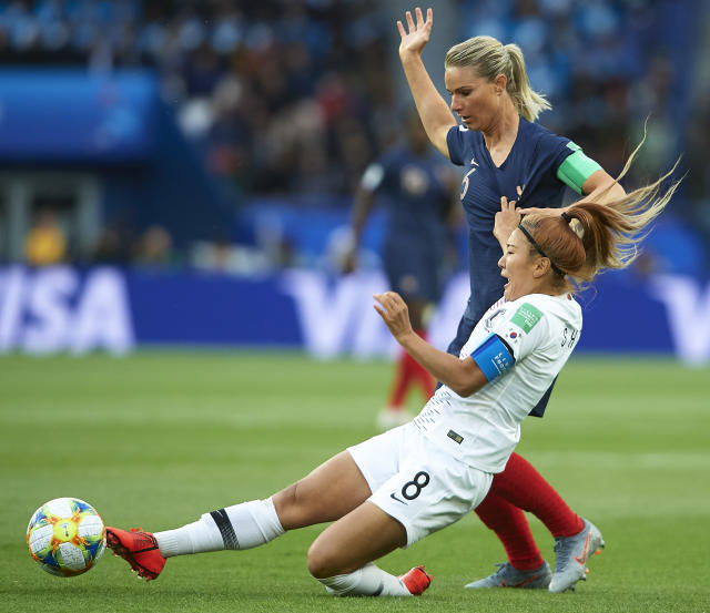 Amandine Henry of France competes for the ball with Cho Sohyun of Korea Republic during the 2019 FIFA Women's World Cup France group A match between France and Korea Republic at Parc des Princes on June 07, 2019 in Paris, France. (Photo by Quality Sport Images/Getty Images)