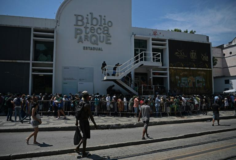 People queue at a food distribution center in Rio de Janeiro, Brazil on March 24, 202