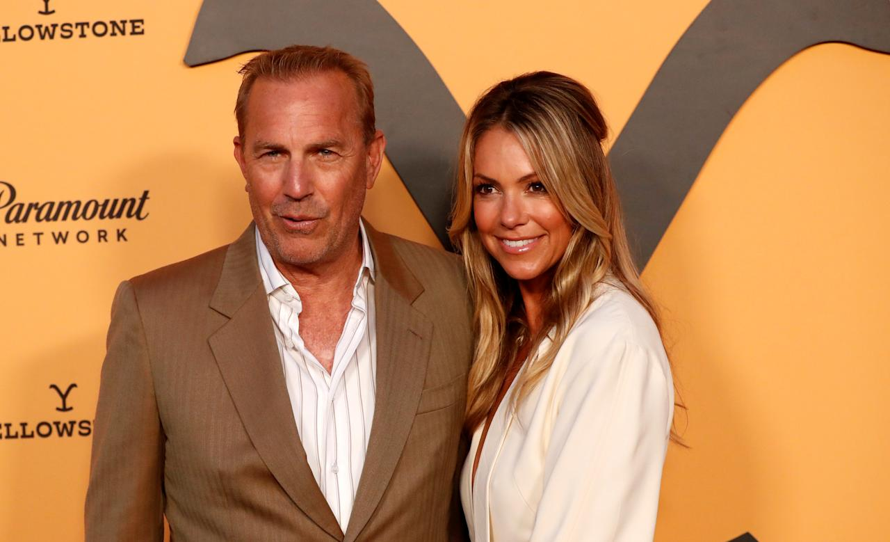 """Cast member Kevin Costner and his wife Christine Baumgartner pose at a premiere party for season 2 of the television series """"Yellowstone"""" in Los Angeles, California, U.S., May 30, 2019. REUTERS/Mario Anzuoni"""