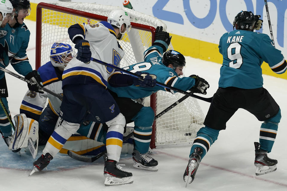 San Jose Sharks center Logan Couture, middle right, celebrates with left wing Evander Kane (9) after scoring against the St. Louis Blues during the third period of an NHL hockey game in San Jose, Calif., Monday, March 8, 2021. (AP Photo/Jeff Chiu)