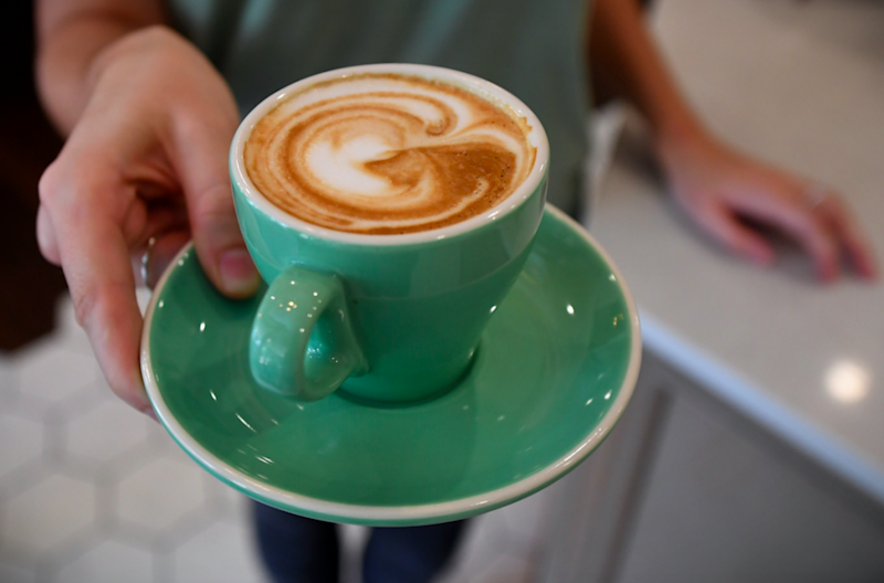 Coffee won't get any cheaper but many will find it harder to pay rent: Greens MP Adam Bandt said. Photo: AAP
