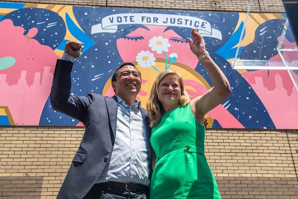 """Mayoral candidates Andrew Yang and Kathryn Garcia wave to New Yorkers after speaking at the AAPI Democracy Project's """"Voting is Justice Rally"""" in Chinatown on Sunday, June 20, 2021, in New York."""