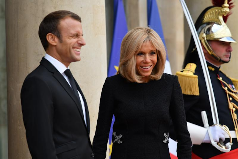 PARIS, FRANCE - SEPTEMBER 30: French President Emmanuel Macron (L) and his wife Brigitte Macron (2nd L) wait to welcome foreign heads of state and government prior to a lunch at the Elysee Presidential Palace on September 30, 2019 in Paris, France. Emmanuel Macron receives at lunch the foreign heads of state and government who made the trip to France to pay tribute to the late President Jacques Chirac. The former president of the French Republic, Jacques Chirac, who died at the age of 86, is buried today at the Montparnasse cemetery in Paris. (Photo by Julien Mattia/Anadolu Agency via Getty Images)
