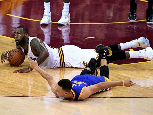 LeBron James and Stephen Curry and a joke about not taking it lying down. (Getty Images)