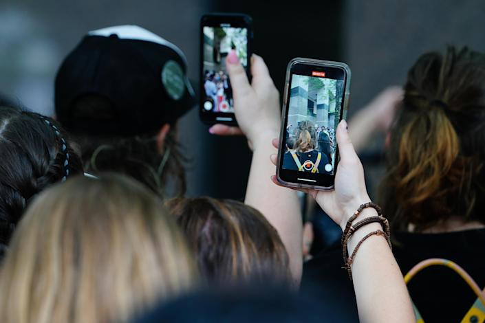 People use their cell phones to record a speaker during a protest over the death of George Floyd while in Minneapolis police custody on June 6, 2020 in Atlanta, United States. (Elijah Nouvelage/Getty Images)