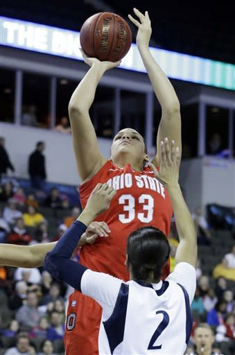 Ohio State center Ashley Adams (33) goes up for a shot against Penn State guard Dara Taylor (2) during the first half of an NCAA women's college basketball game in the Big Ten Conference tournament in Hoffman Estates, Ill., on Friday, March 8, 2013. (AP Photo/Nam Y. Huh)