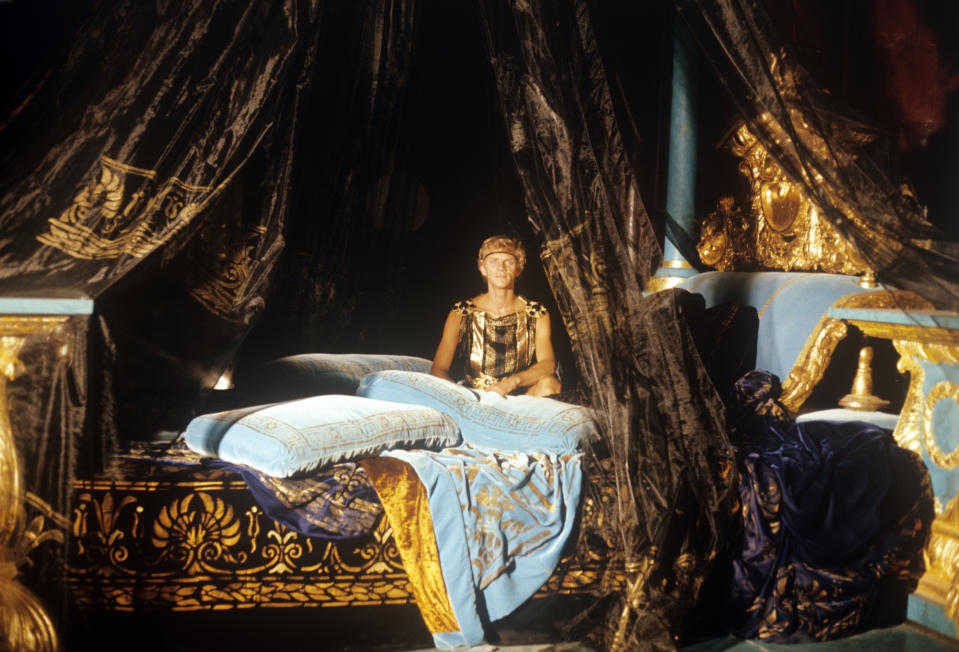 British actor Malcolm McDowell (Malcolm John Taylor) playing the role of the Emperor Caligula sitting on a bed in the film Caligula, My Son. 1979. (Photo by Mondadori via Getty Images)