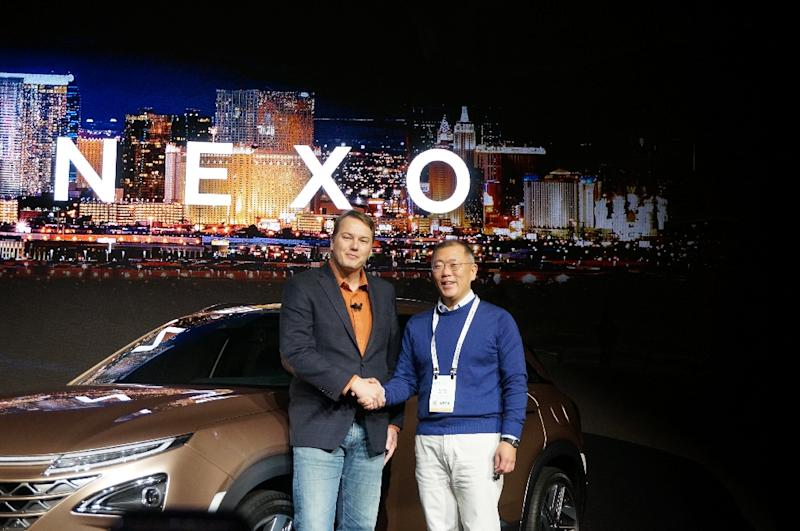 Hyundai vice chairman Eui Sun Chung (R) and Aurora Innovation founder Chris Urmson present the Nexo, a hydrogen fuel-cell powered vehicle, at the International Consumer Electronics Show in Las Vegas