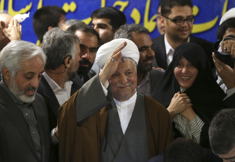 Former President Akbar Hashemi Rafsanjani waves to reporters, as he registers his candidacy for the upcoming presidential election, at the election headquarters of the interior ministry in Tehran, Iran, Saturday, May 11, 2013. Iranian election authorities say several new high-profile politicians including hardliners, reformists, and allies of outgoing President Mahmoud Ahmadinejad have registered for the June 14 presidential elections. The campaign is taking shape as open season on Ahmadinejad's legacy and his combative style that bolstered his stature among supporters but alarmed critics. Ahmadinejad is barred by law from seeking a third term due to term limits under Iran's constitution. (AP Photo/Ebrahim Noroozi)