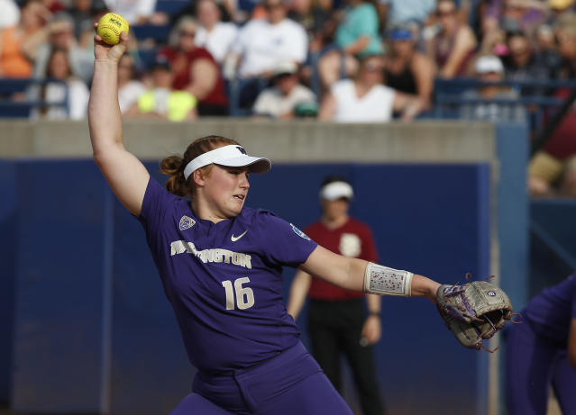 Washington starting pitcher Gabbie Plain (16) pitches in the third inning of the first game of the best-of-three championship series against Florida State in the NCAA Women's College World Series in Oklahoma City, Monday, June 4, 2018. Plain is a freshman from Australia who is a part of her countrys national program. (AP Photo/Sue Ogrocki)