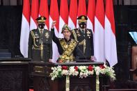 Indonesian President Joko Widodo dressed in a traditional Indonesian traditional costume from Sabu, gestures as he delivers a speech ahead of the 75th Independence Day, at the parliament building in Jakarta