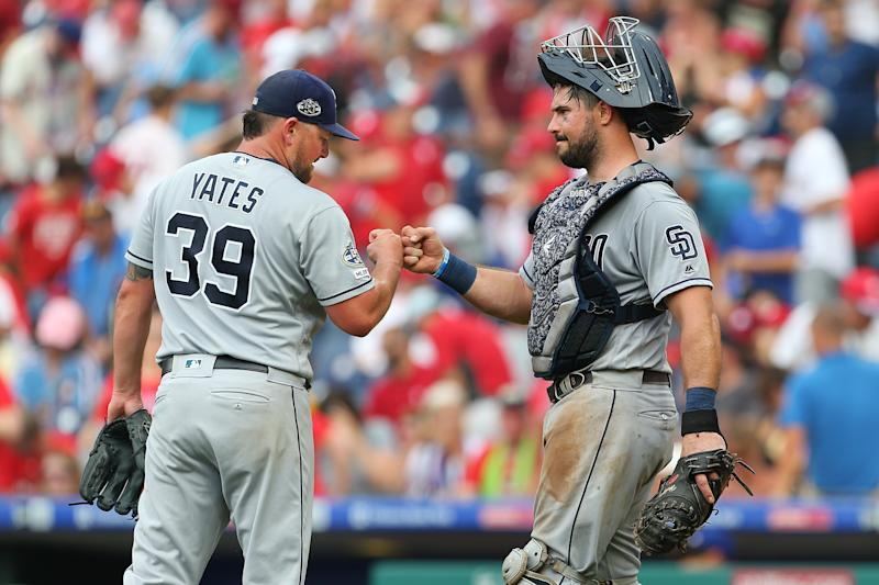 PHILADELPHIA, PA - AUGUST 18: Pitcher Kirby Yates #39 fist bumps catcher Austin Hedges #18 after defeating the Philadelphia Phillies 3-2 in a game at Citizens Bank Park on August 18, 2019 in Philadelphia, Pennsylvania. (Photo by Rich Schultz/Getty Images)