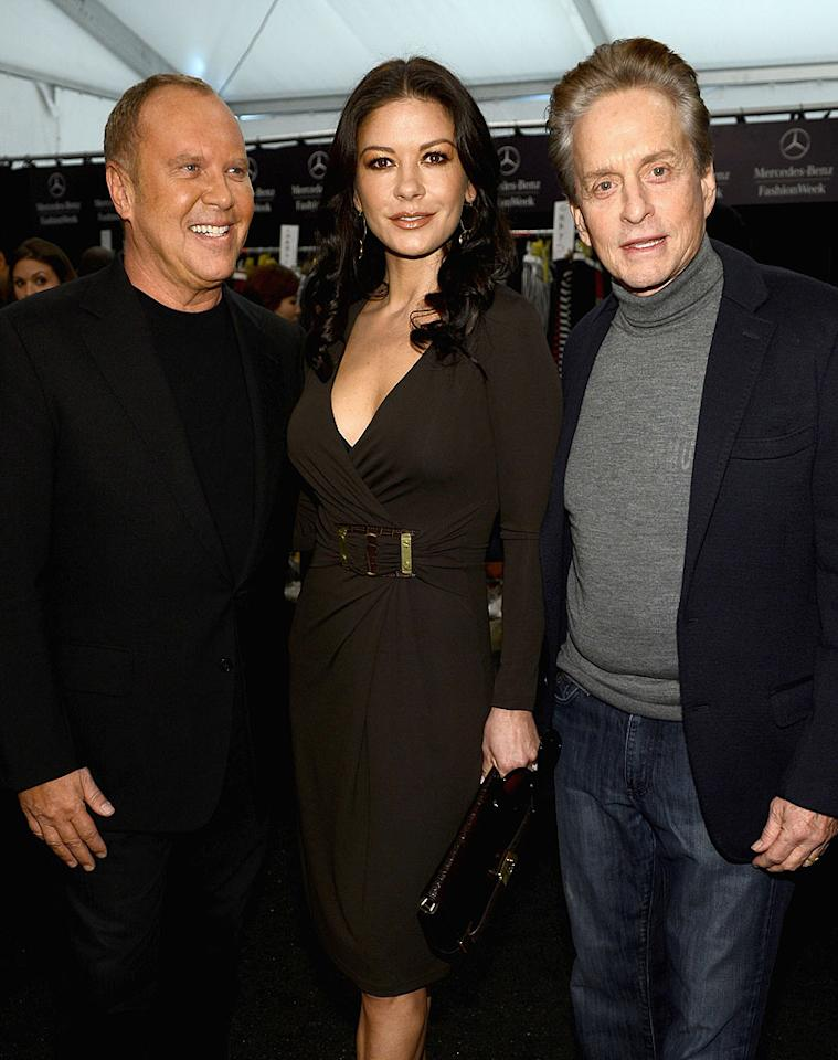 Designer Michael Kors made sure to take advantage of a photo op with his A-list pals Catherine Zeta-Jones and Michael Douglas, backstage at his show at the Theatre at Lincoln Center. (9/12/12)