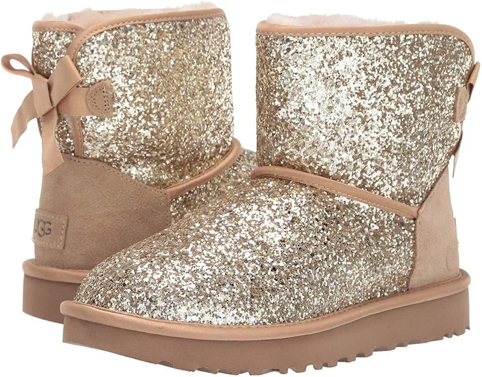 <p>Sparkle-lovers need these <span>UGG Classic Mini Bow Cosmos Boots</span> ($180).</p>