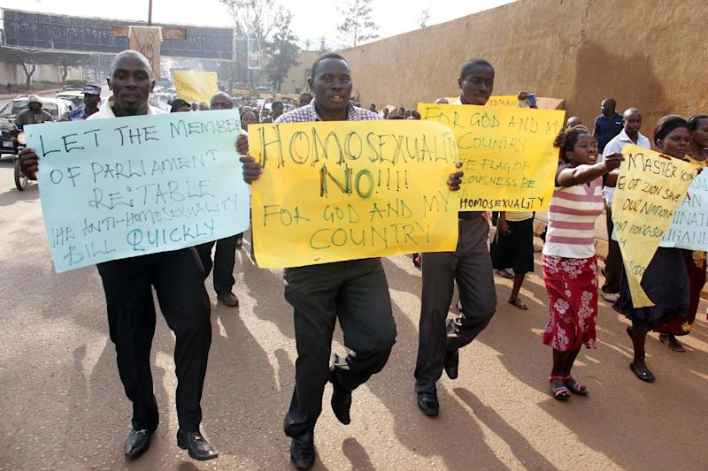 Anti-homosexual activists march in Kampala on August 11, 2014 to demonstrate against the annulment of an Anti-Gay law by Uganda''s constitutional court