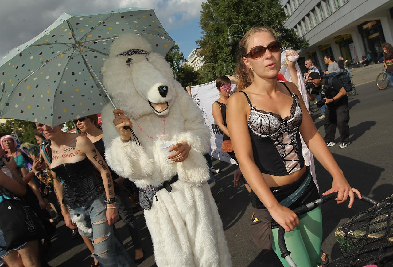 "BERLIN, GERMANY - AUGUST 13: People, including one person dressed as a dog, participate the ""Slut Walk"" march on August 13, 2011 in Berlin, Germany. Several thousand men and women turned out to protest against rape and a woman's right to her body.  (Photo by Sean Gallup/Getty Images)"