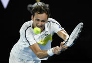 Russia's Daniil Medvedev hits a backhand return to Greece's Stefanos Tsitsipas during their semifinal match at the Australian Open tennis championship in Melbourne, Australia, Friday, Feb. 19, 2021.(AP Photo/Andy Brownbill)