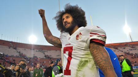 San Francisco 49ers quarterback Colin Kaepernick pumps his fist as he acknowledges the cheers at Los Angeles Memorial Coliseum in Los Angeles, California, U.S. on December 24, 2016.  REUTERS/Robert Hanashiro/USA TODAY Sports/File Photo